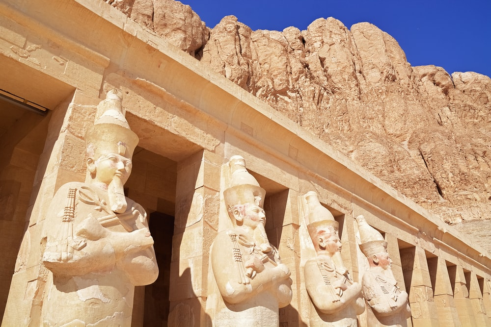 white concrete statues under blue sky during daytime