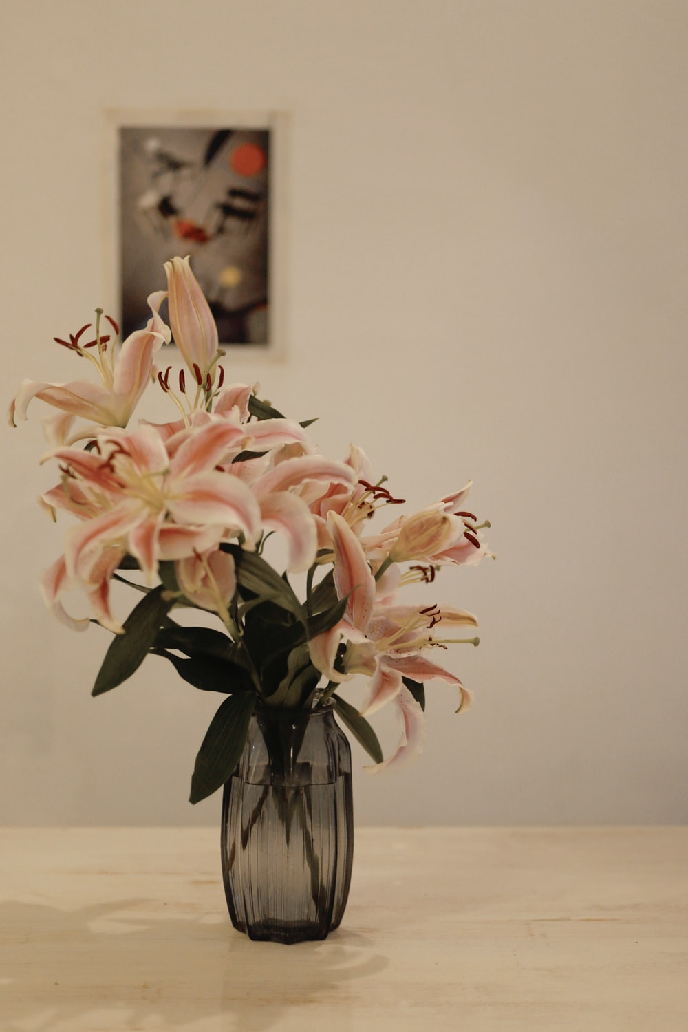 white and pink flowers in clear glass vase
