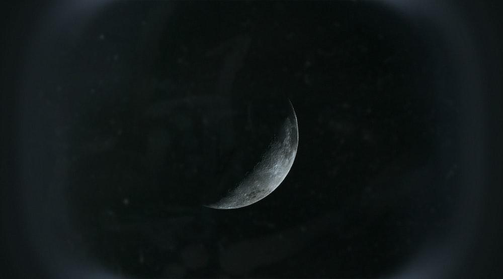 black moon in dark night sky