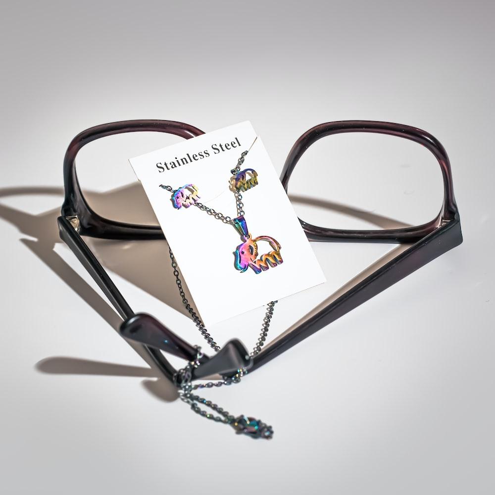 brown framed eyeglasses on white table