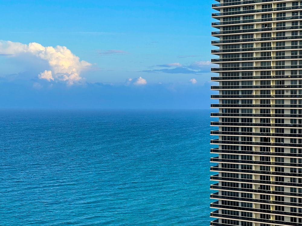 high rise building near sea under blue sky during daytime