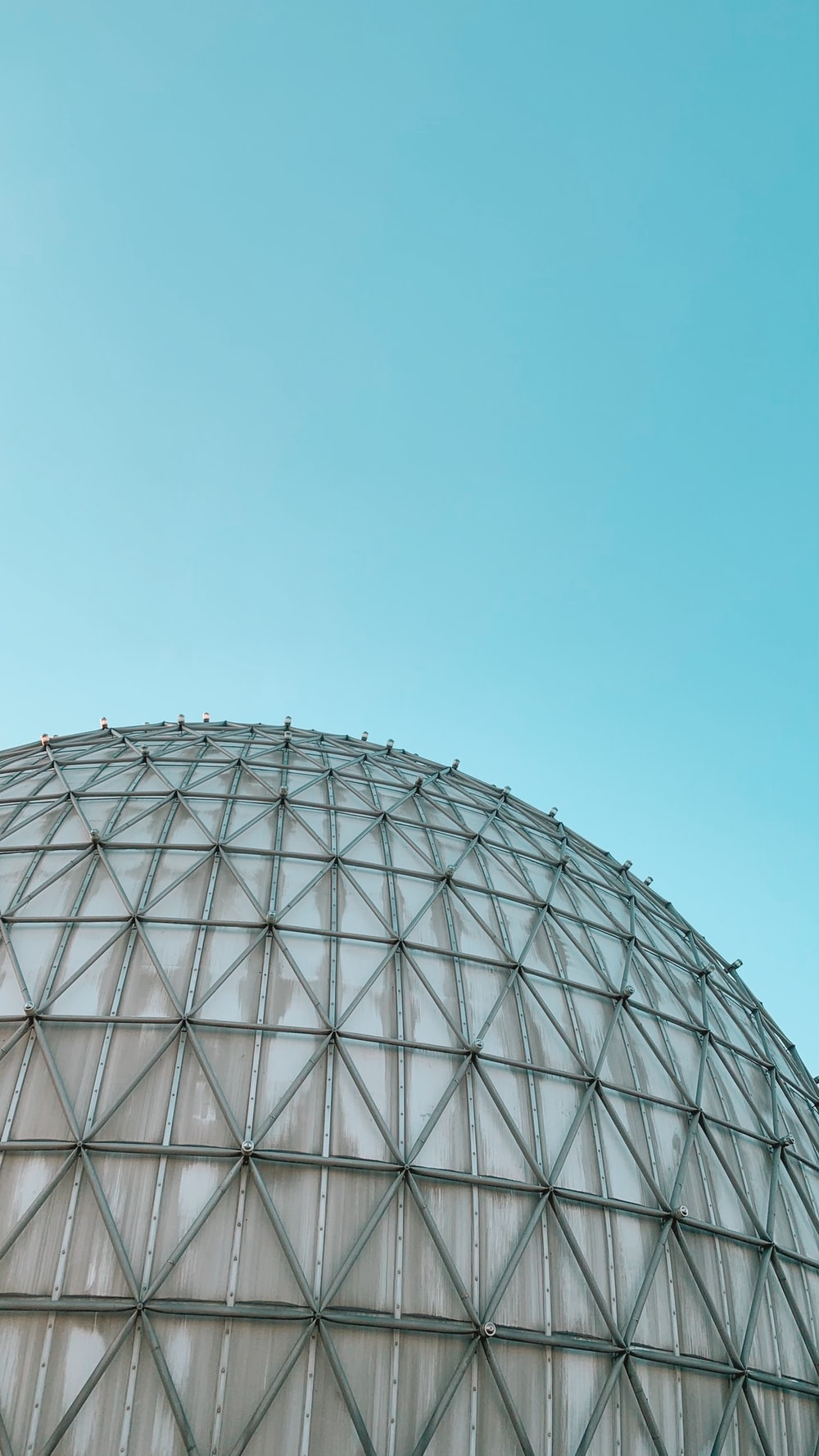 gray round building under blue sky during daytime