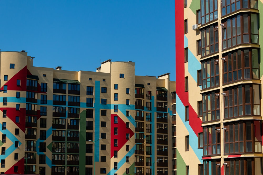 white red and green concrete building under blue sky during daytime