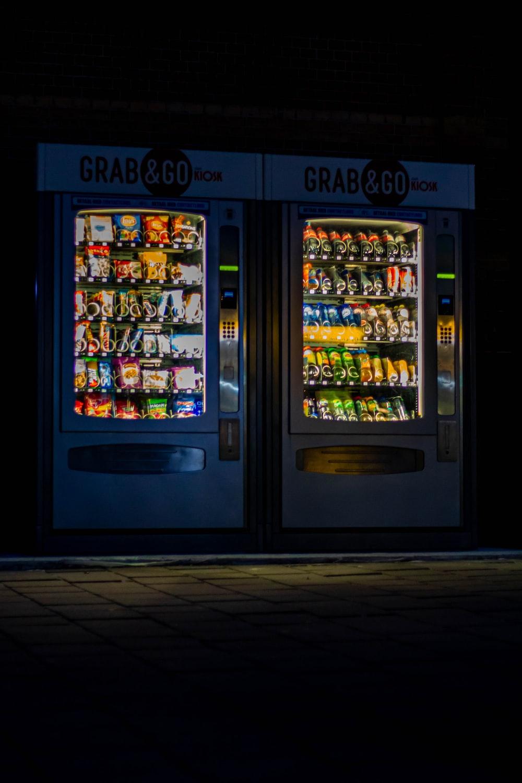 black and yellow vending machine