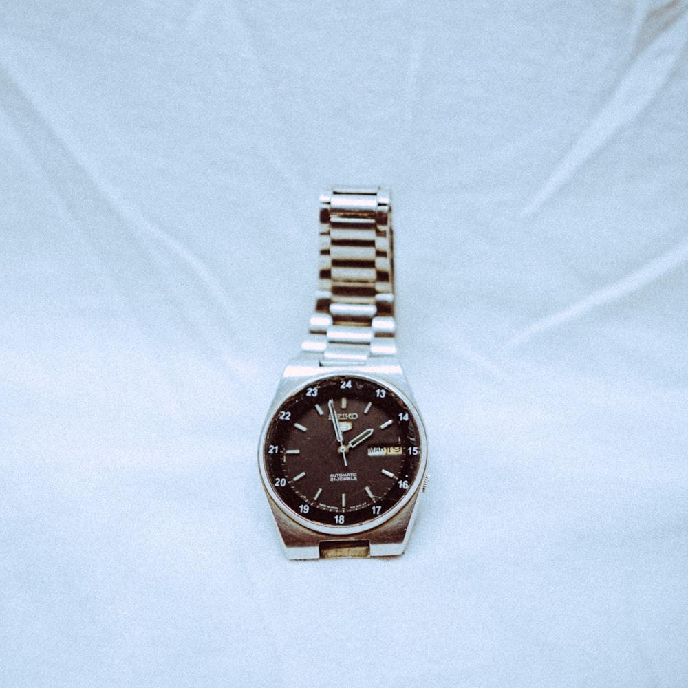 silver link bracelet round analog watch