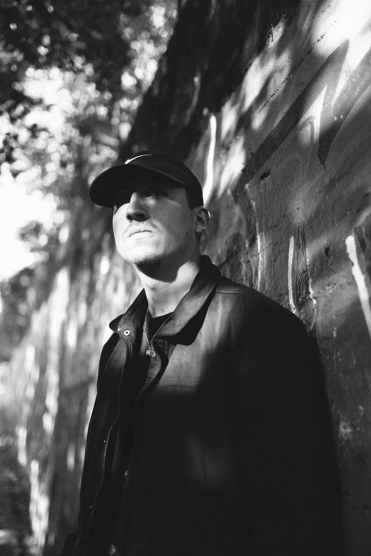 man in black suit jacket and black hat