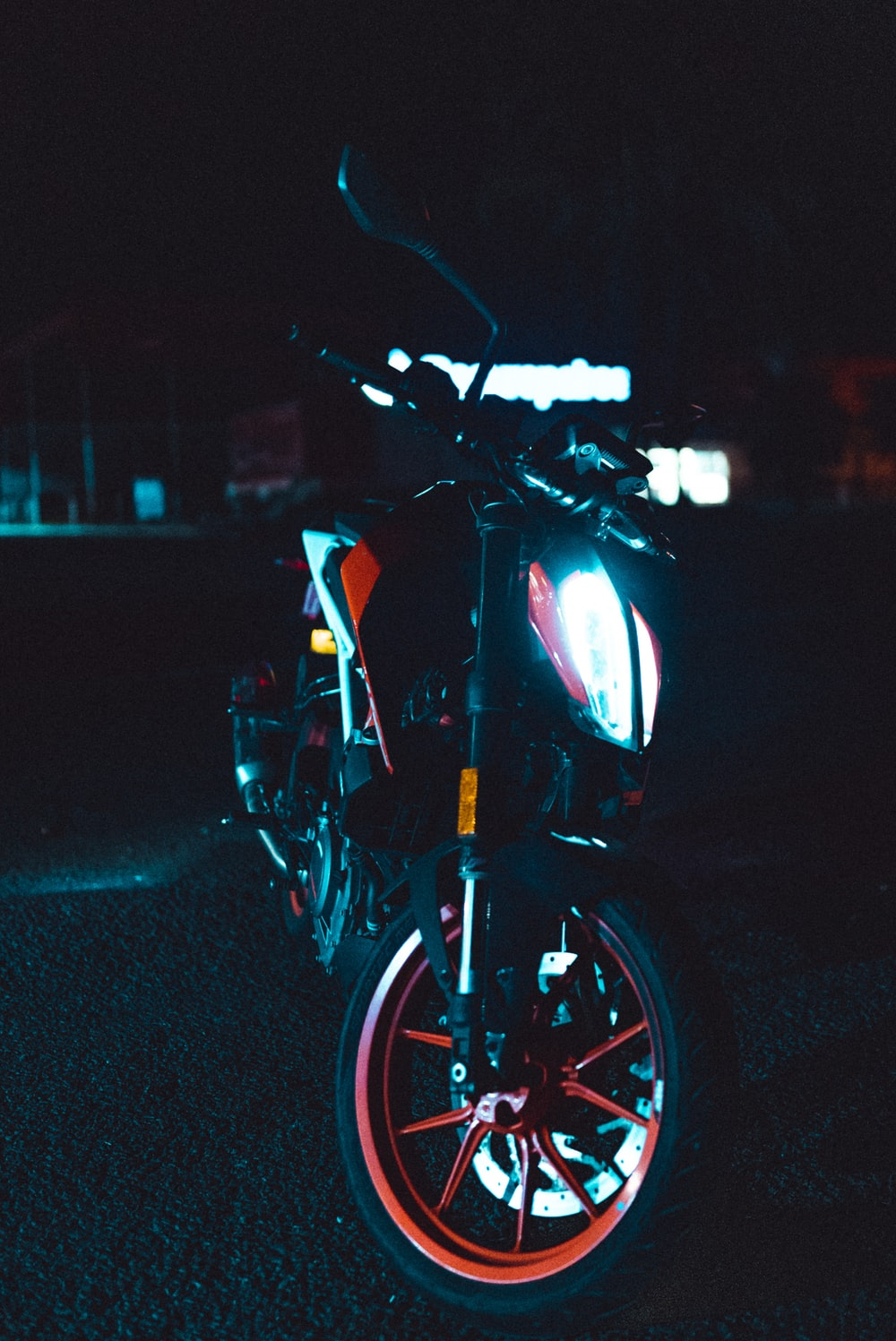 black and yellow motorcycle on road during night time
