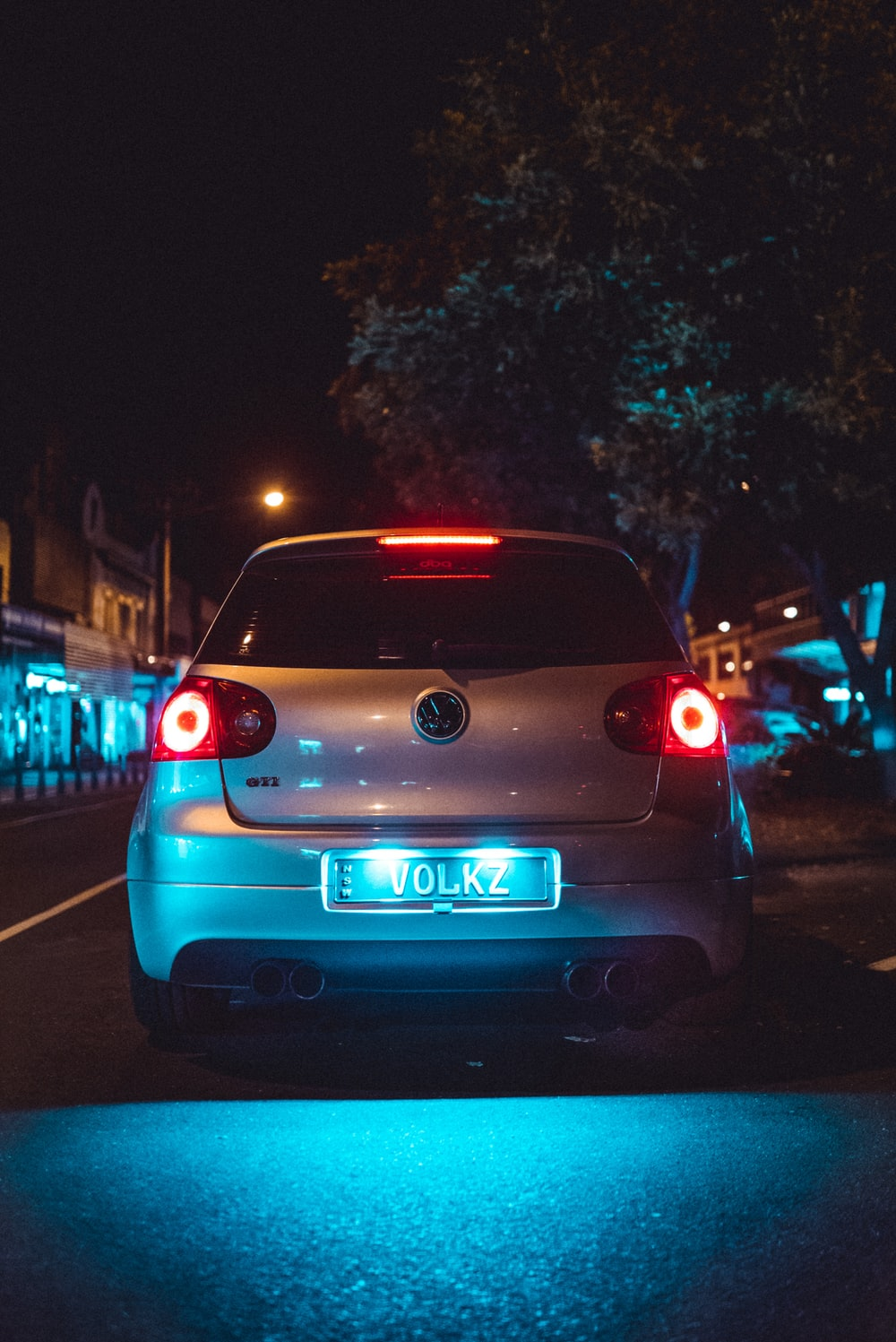 blue car on the road during night time