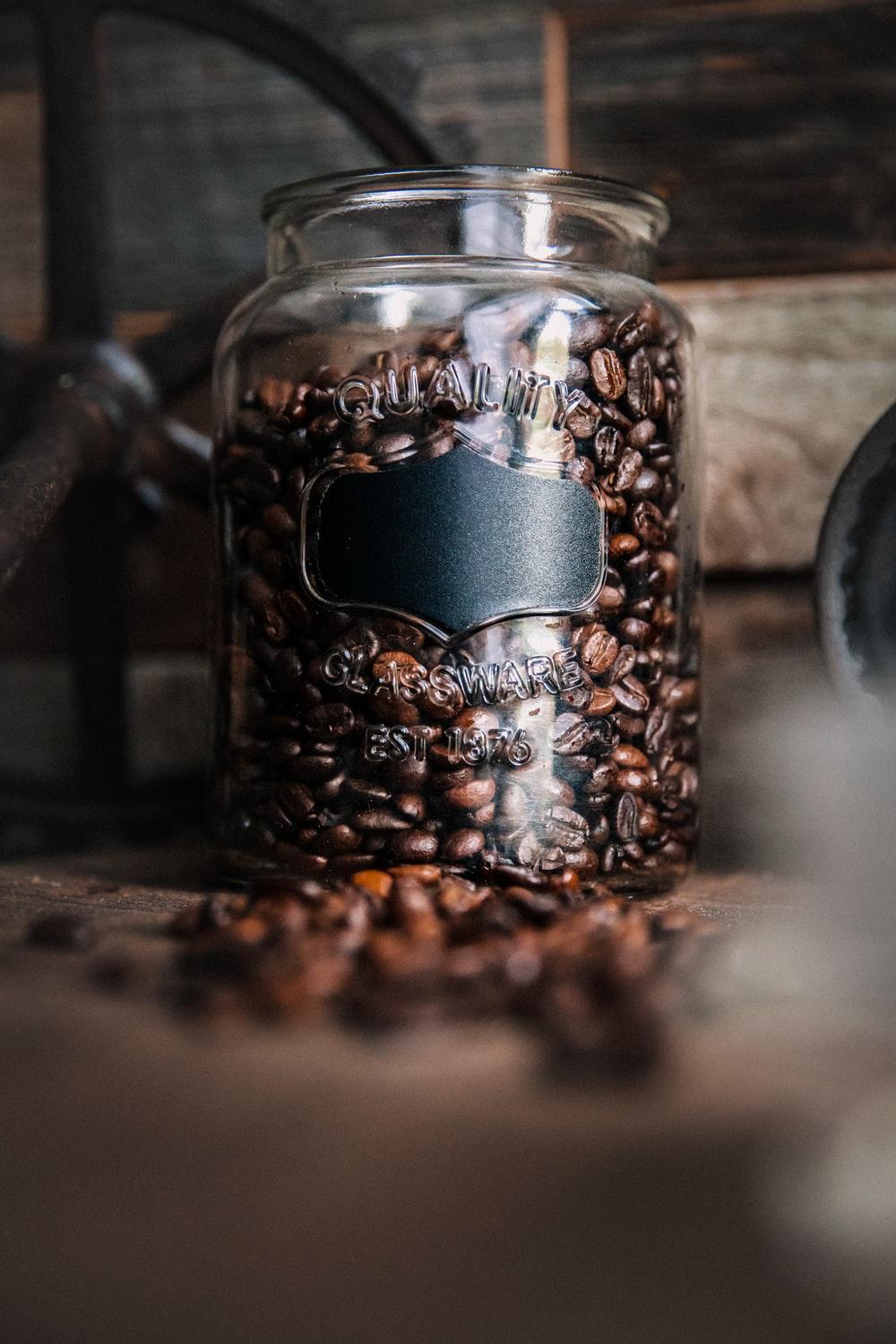 brown and black coffee beans in clear glass mug