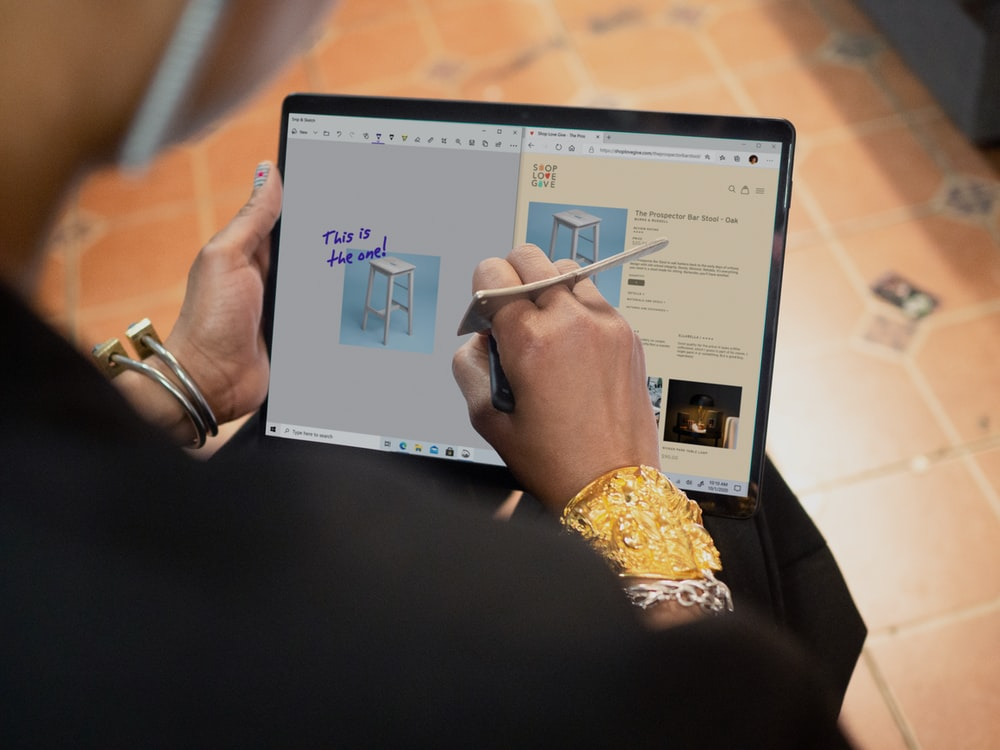 person using Surface computer on table