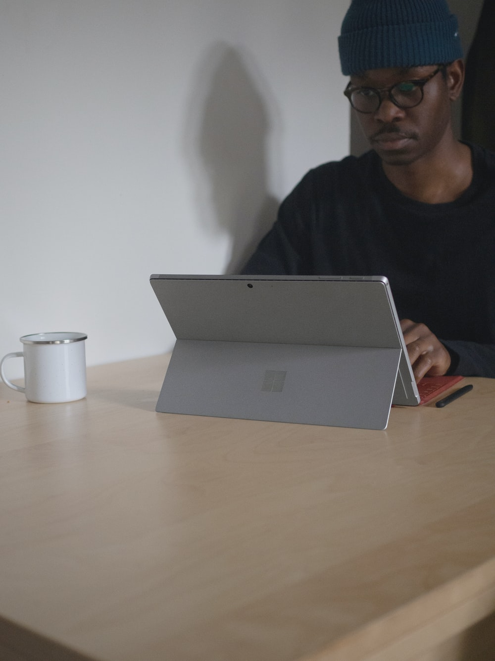 man using Surface device