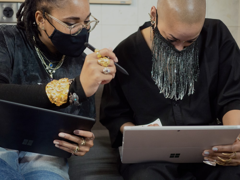 two people using Surface devices