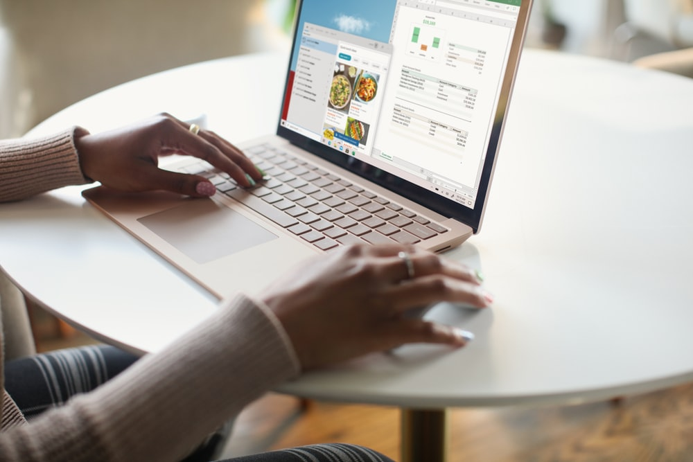 person in gray long sleeve shirt using Surface computer