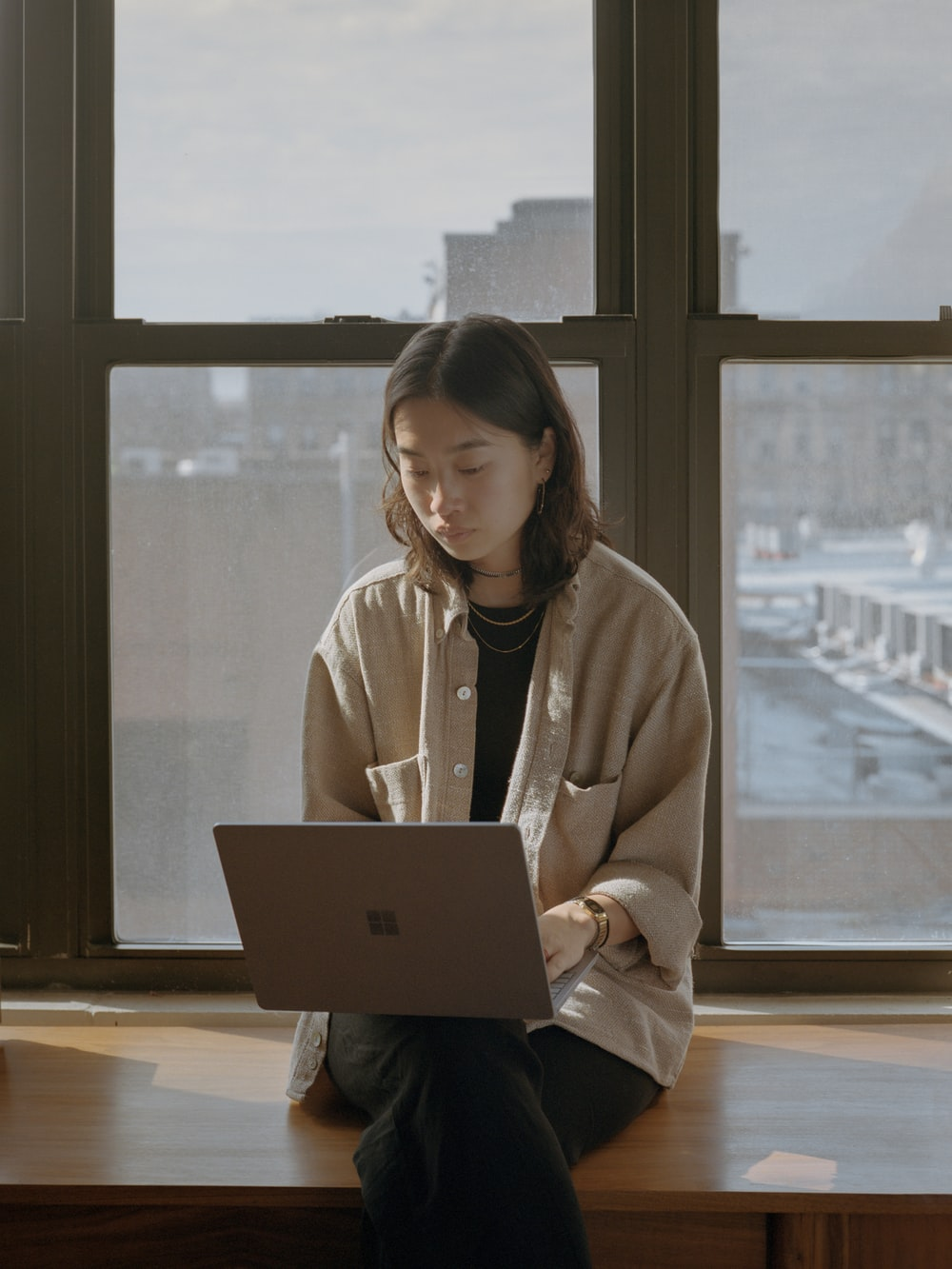 woman in white shirt using Surface computer