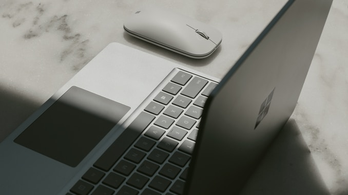 Surface laptop next to mouse