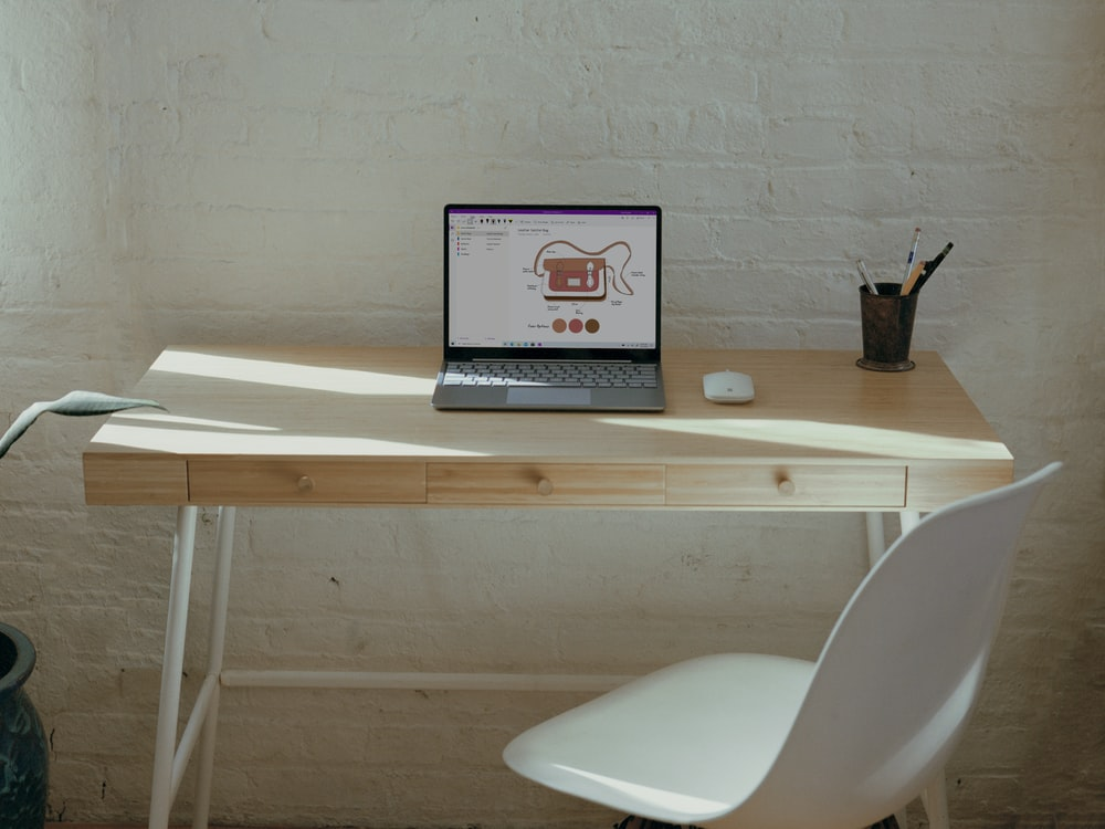 Surface computer on brown wooden table