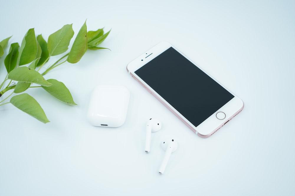 silver iphone 6 beside white apple earpods