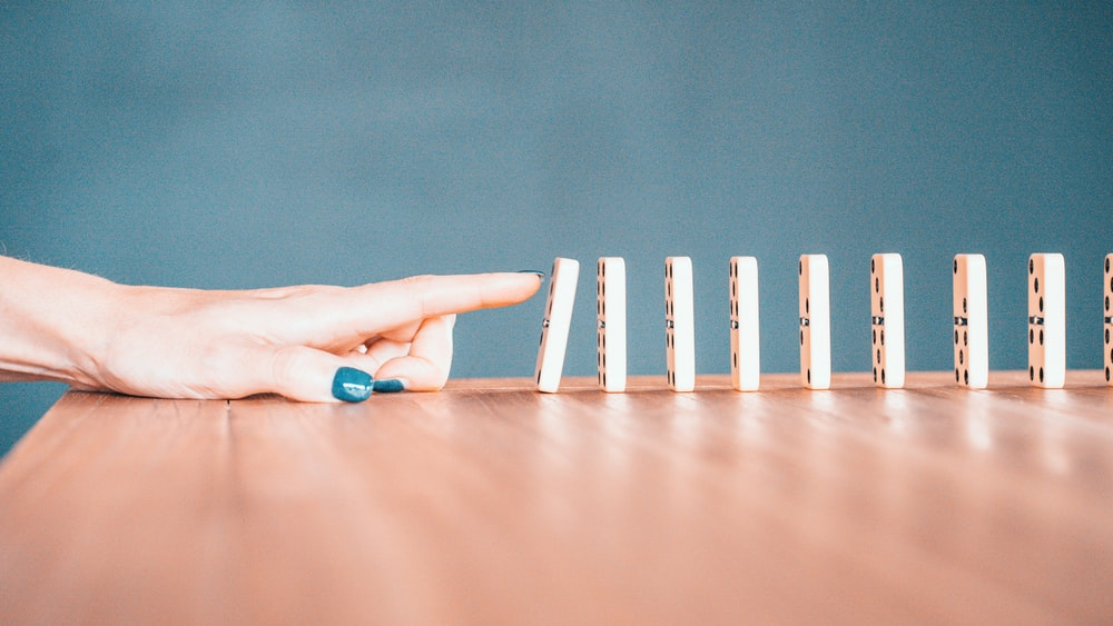 person holding white and blue plastic blocks