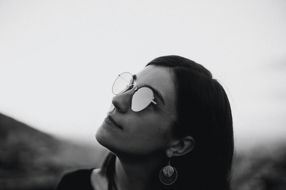 woman wearing silver framed aviator sunglasses