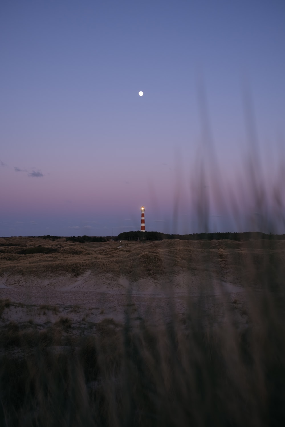 silhouette of lighthouse during daytime