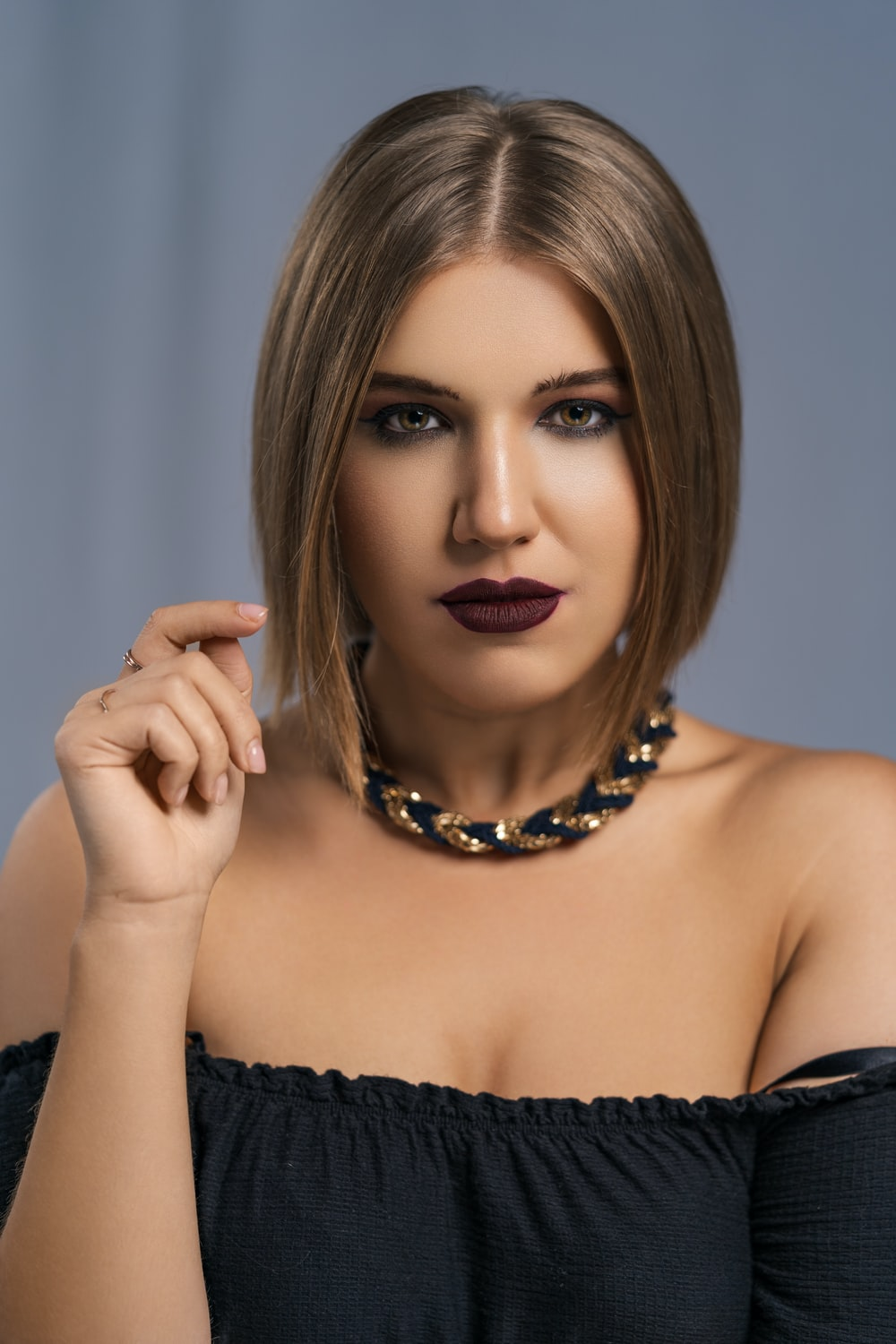 woman in black tube top wearing black beaded necklace