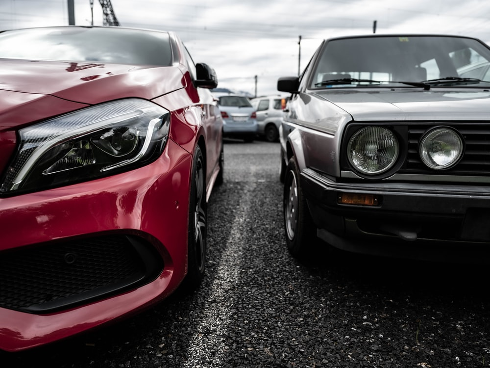 red bmw m 3 parked on parking lot during daytime