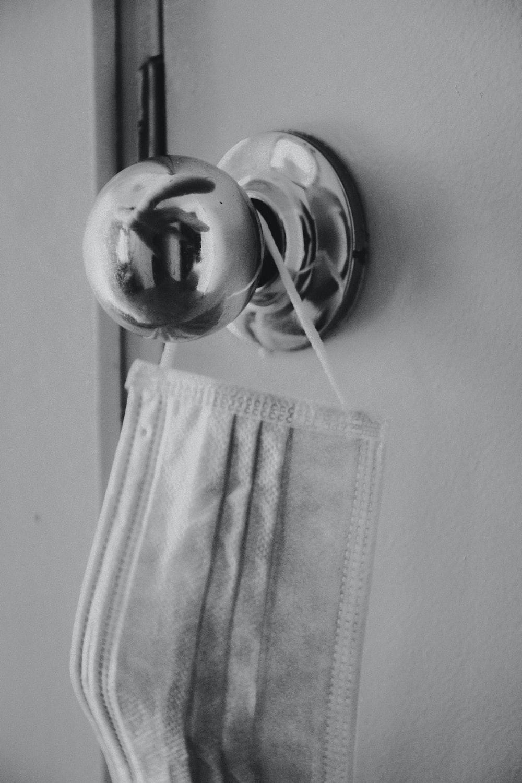 white towel on white metal towel rack