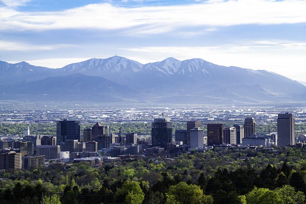 city skyline across green mountain during daytime