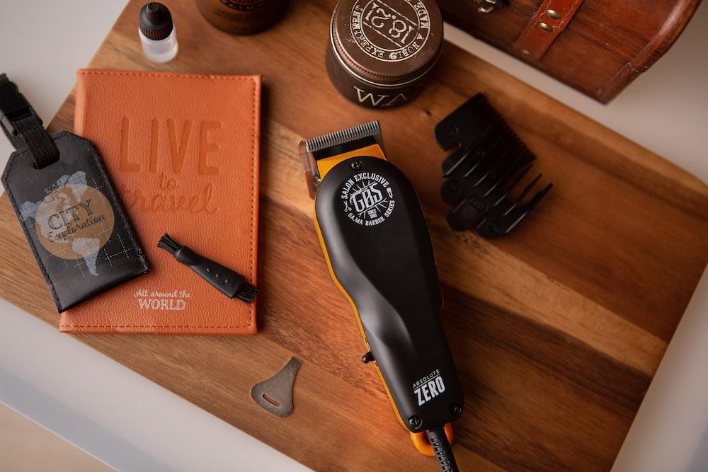 black hair brush on brown wooden table