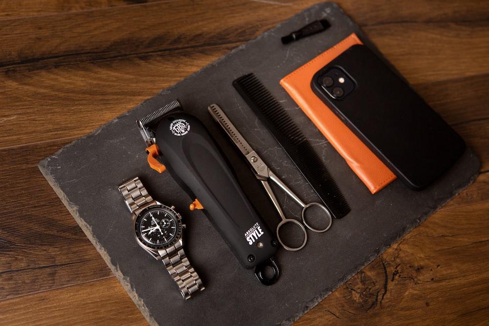 black iphone 5 with orange and black case
