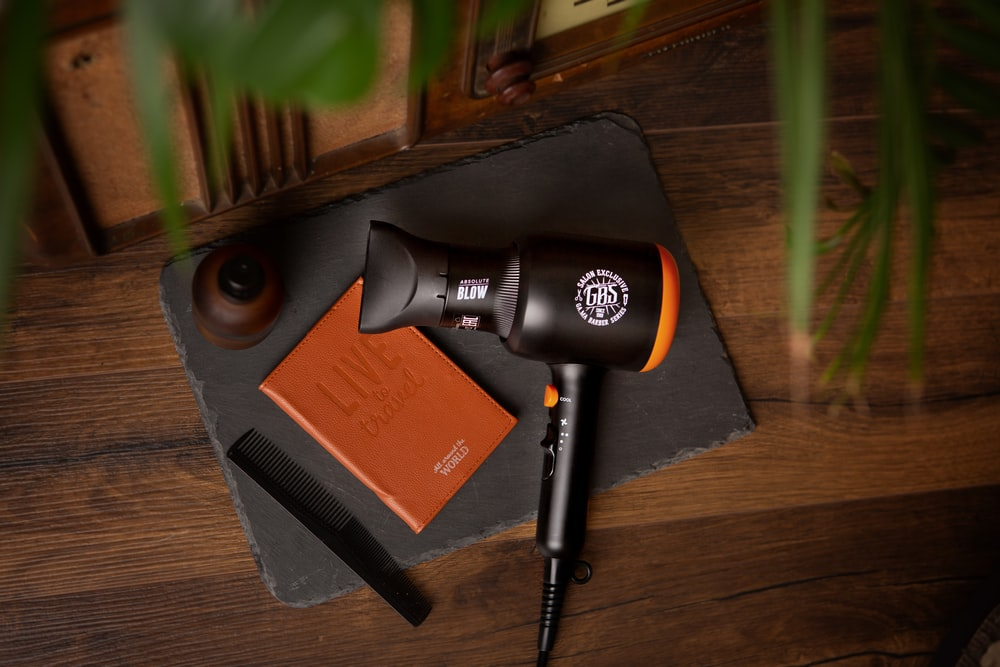 black and orange microphone on brown wooden table