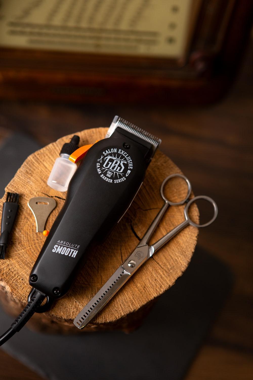 black and silver scissors beside silver scissors