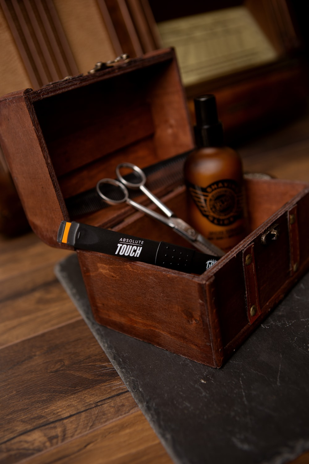 black and silver scissors on brown wooden box