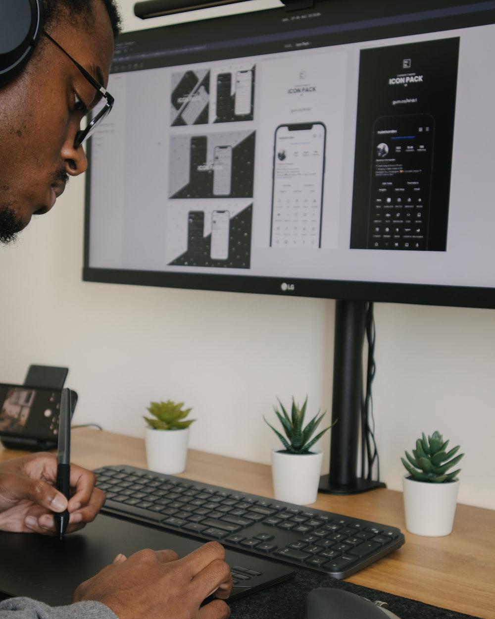 man in black framed eyeglasses holding black smartphone