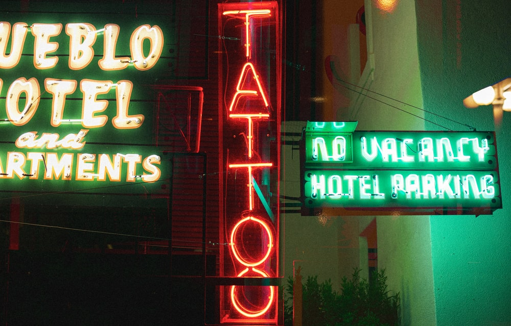 red and white UNKs neon light signage