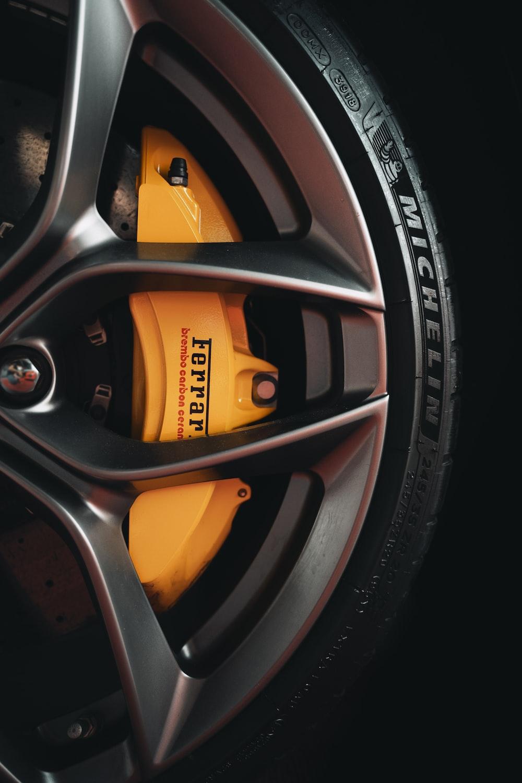 black and yellow 5 spoke car wheel