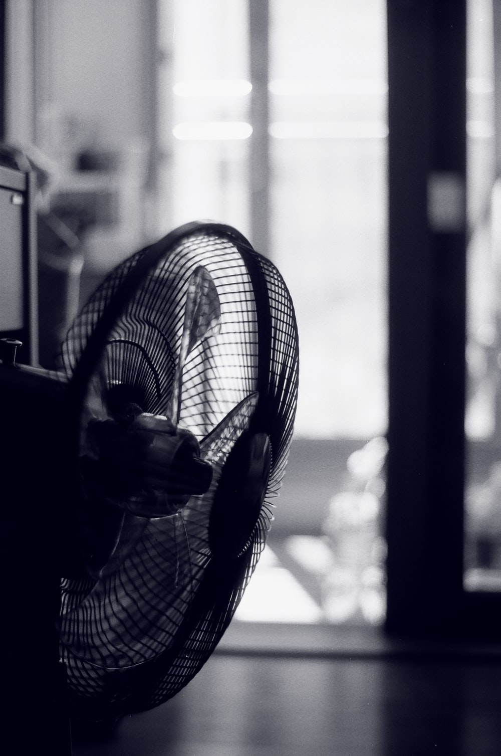 black and white photo of pedestal fan