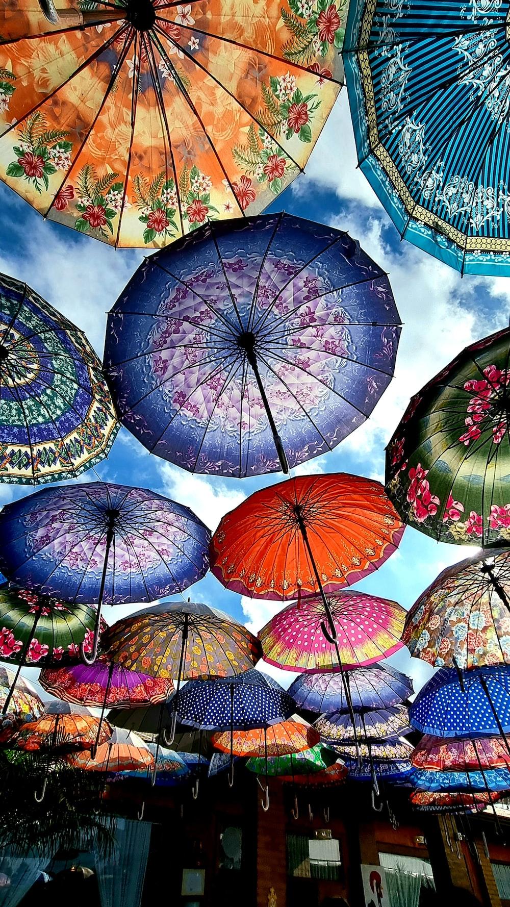 assorted umbrellas under blue sky during daytime