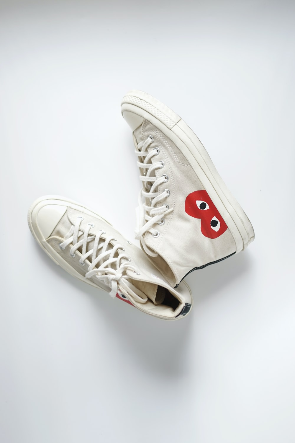 white and red nike athletic shoes