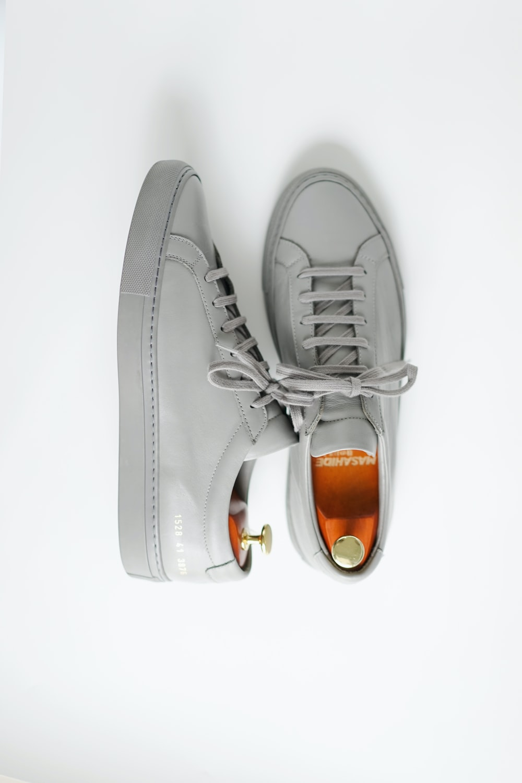 gray and orange nike low top sneakers