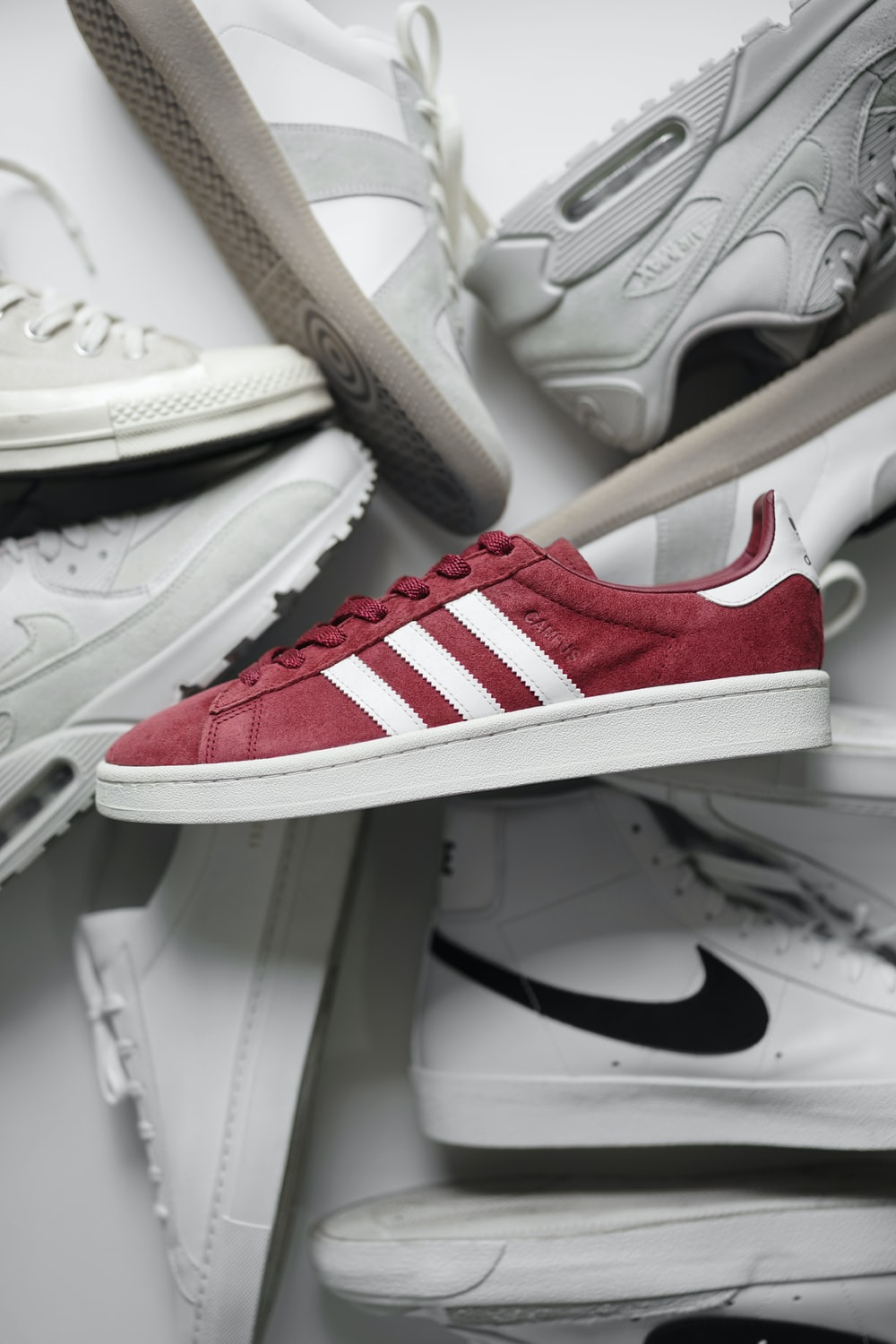 red and white adidas low top sneakers