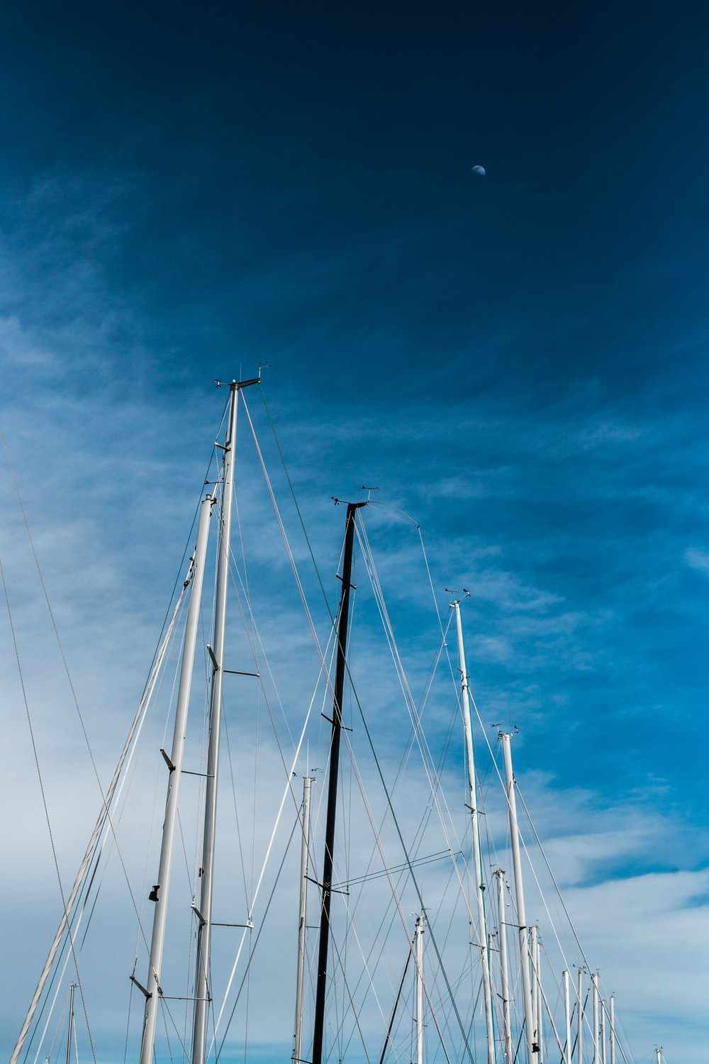 white sail boat on sea under blue sky during daytime