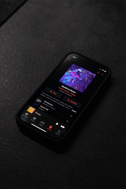 black android smartphone on black textile