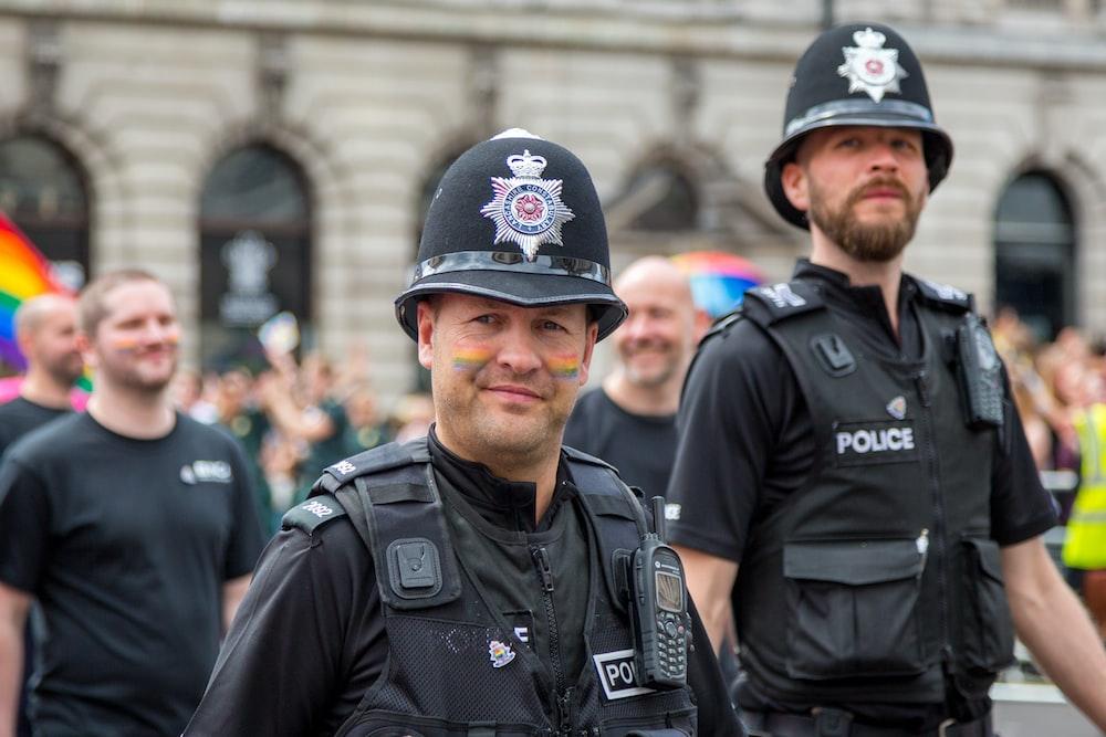 man in black police uniform wearing black helmet