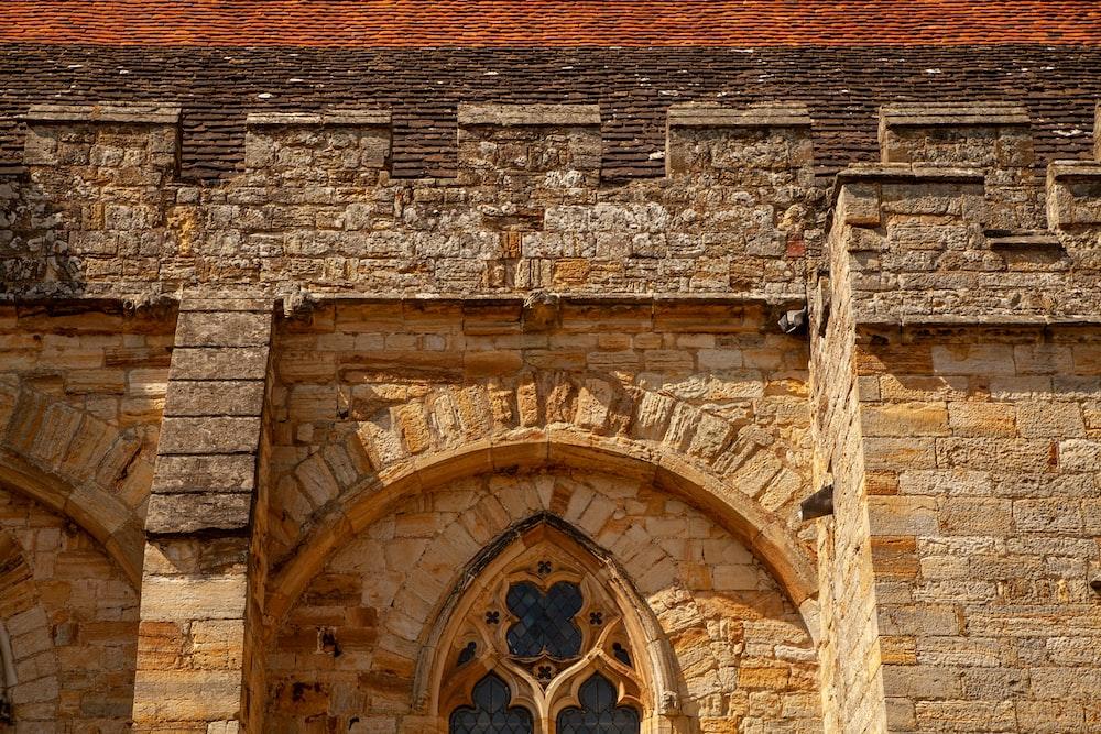 brown brick building with brown wooden door