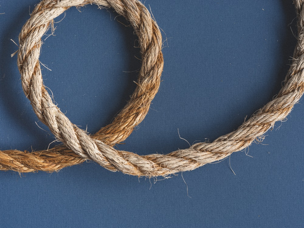 brown rope on blue textile
