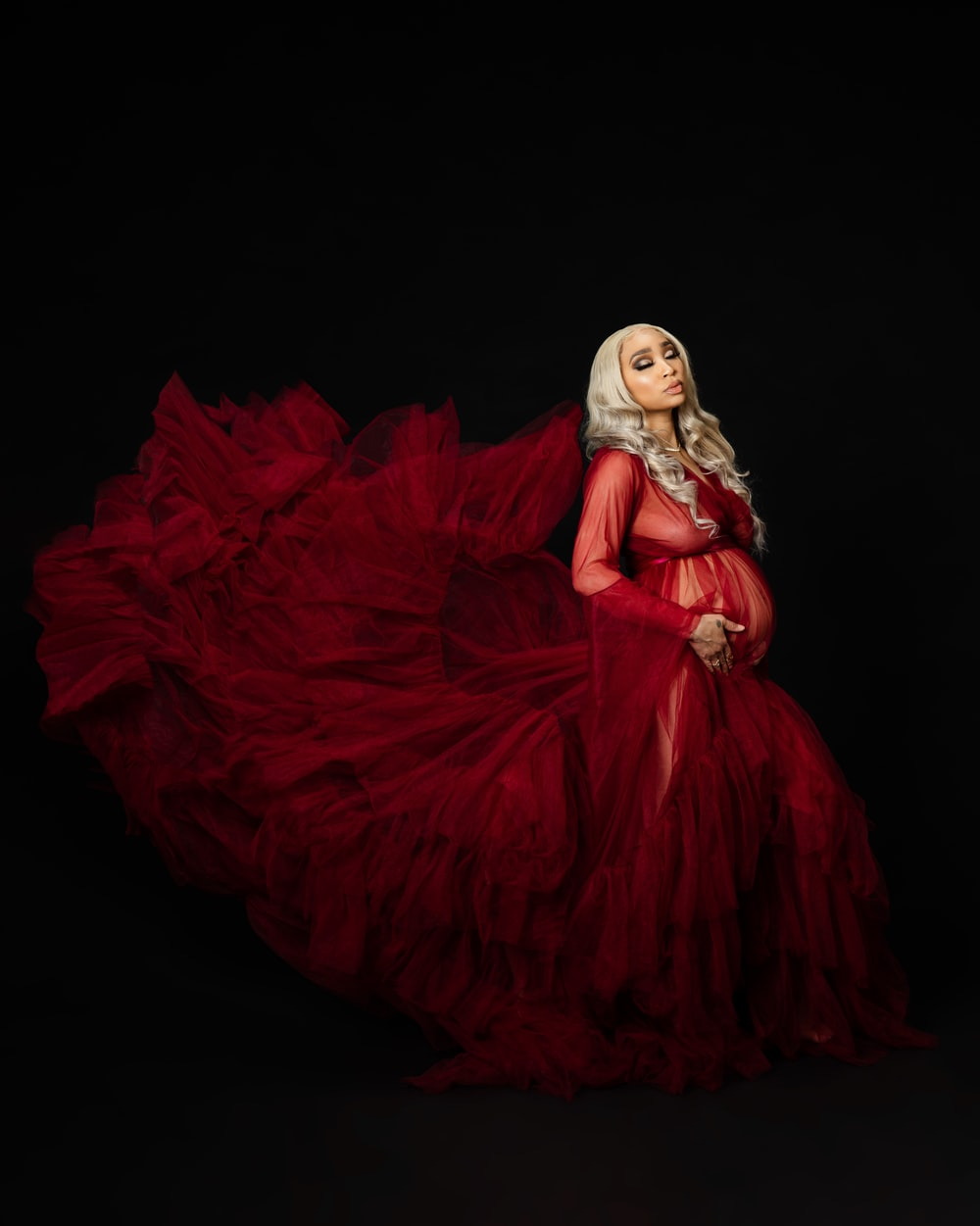 woman in red dress with white hair