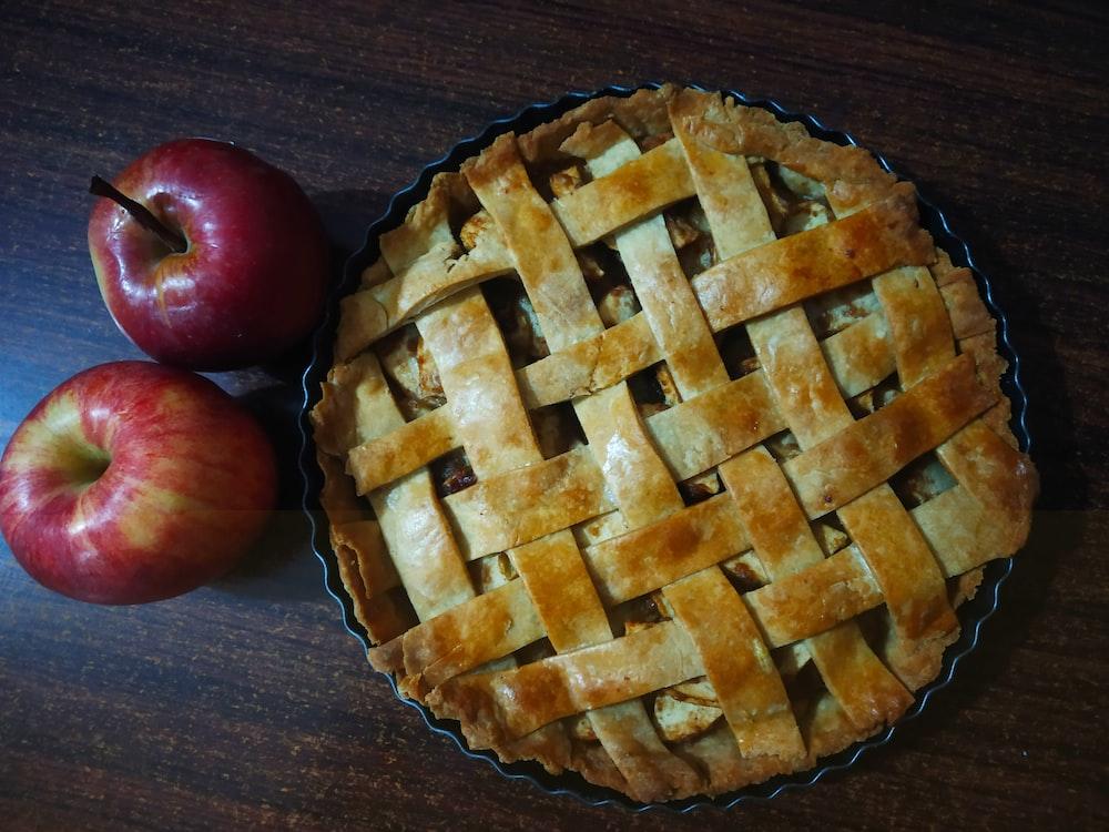 red apple beside brown pie