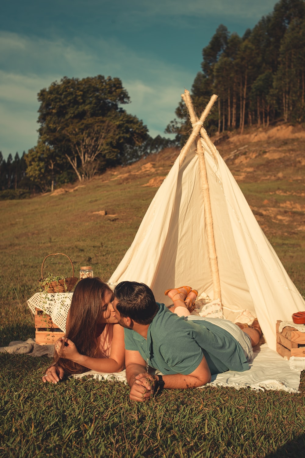 man and woman sitting on white tent during daytime
