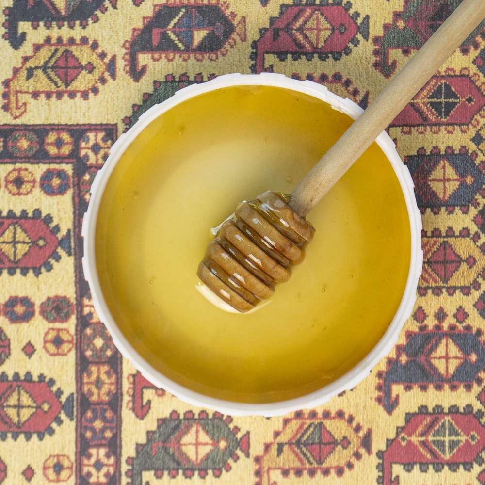 yellow ceramic bowl with silver fork